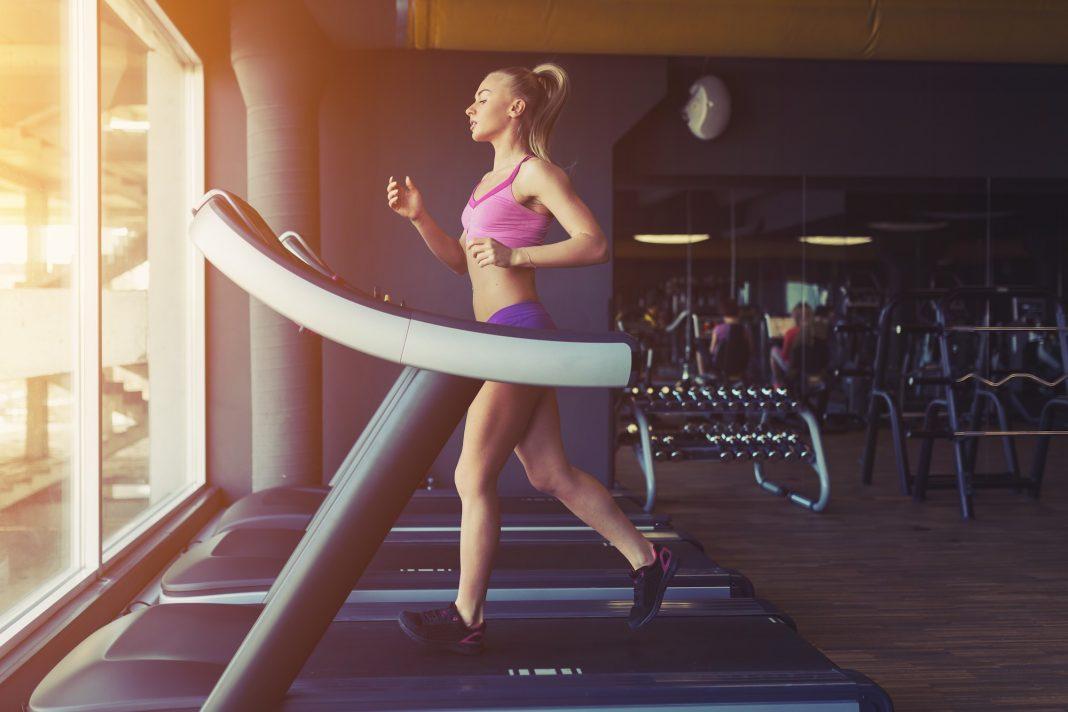 fitness girl running treadmill